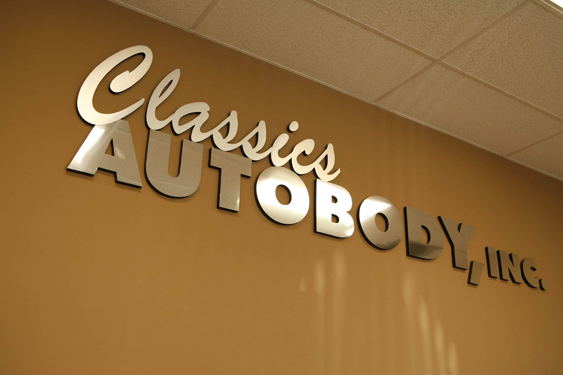Classics-Autobody-sign-in-office